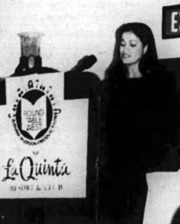 Tracey Davis speaking at a La Quinta author showcase in 1996